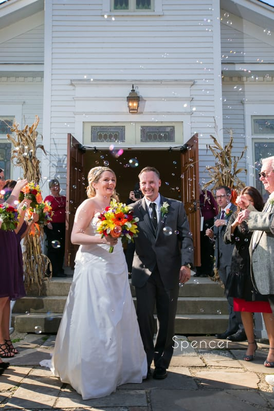 bride and groom greet guests outside Frostville Church
