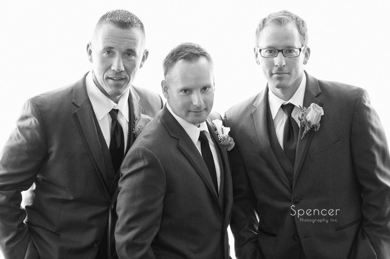 creative black and white picture of groom with groomsmen