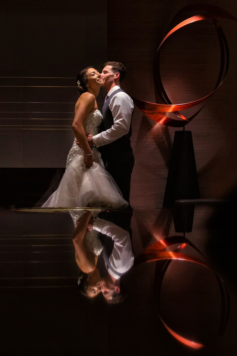 bride and groom kissing on wedding day at hilton akron
