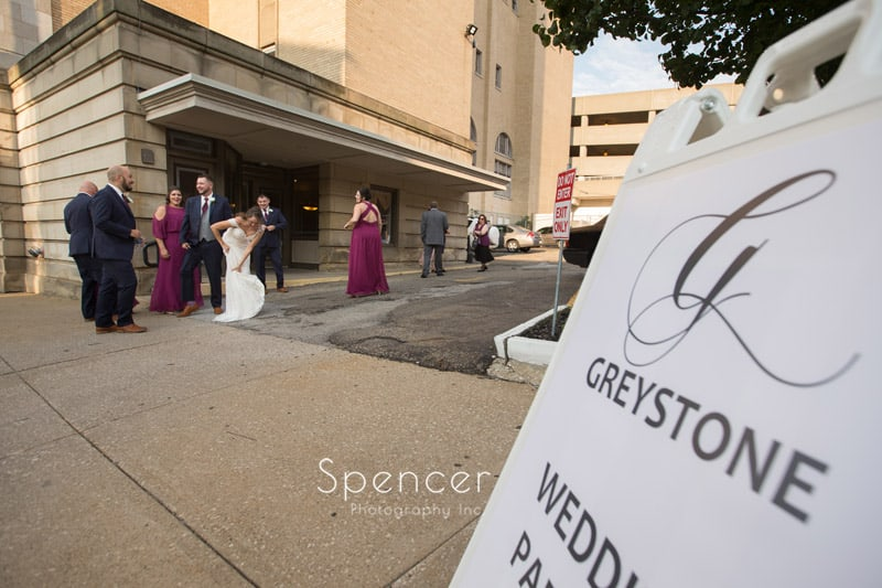 bride fixing her dress at Greystone Hall reception
