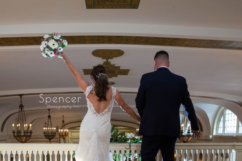 bride and groom enter their wedding reception at Greystone Hall Akron