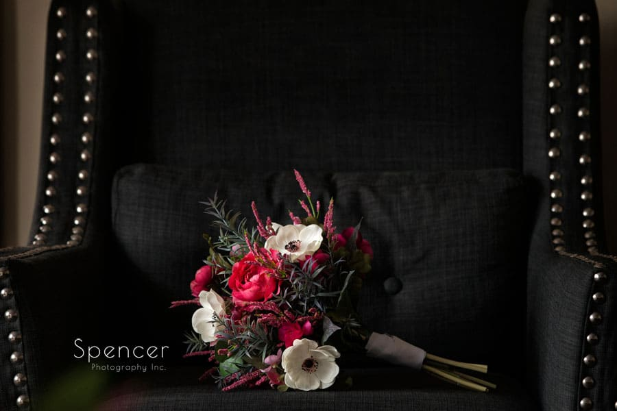brides wedding bouquet sitting in chair at Greystone