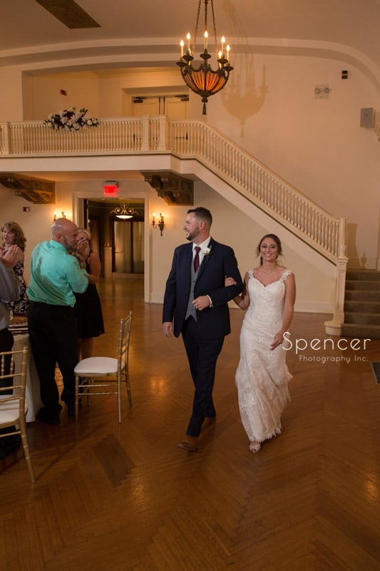 bride and groom greeting guests at wedding reception Greystone