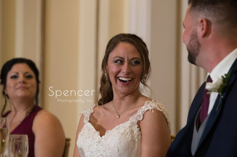 bride laughing at speech during reception at Greystone Akron