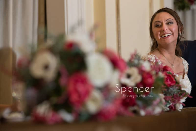 bride and reception flowers at Greystone Hall