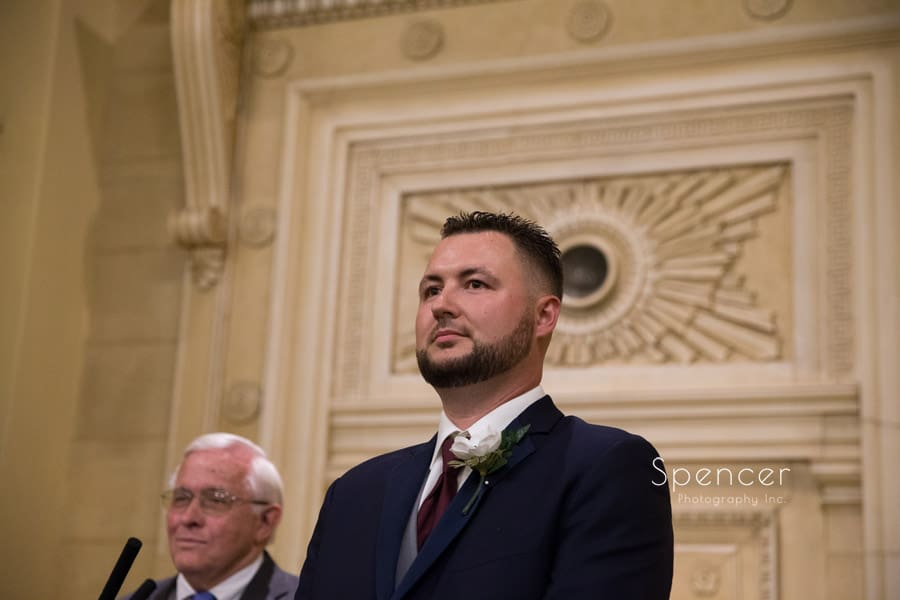 groom watching bride walk down Greystone wedding aisle