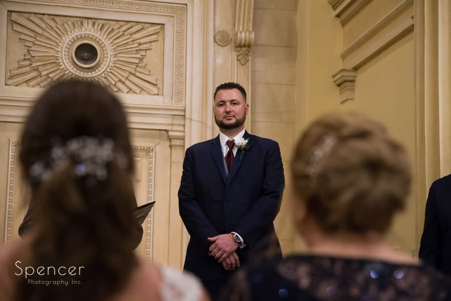 groom looking at bride on altar of Greystone Hall