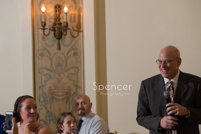 father of the groom gives speech at wedding reception