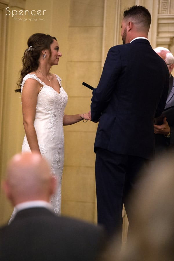 exchanging rings at Greystone Hall wedding ceremony