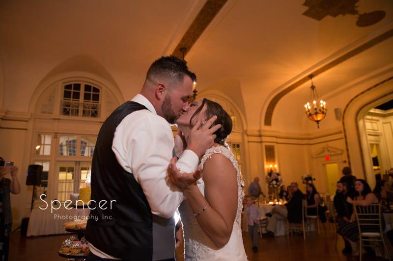 bride a groom kissing at wedding reception at Greystone Hall