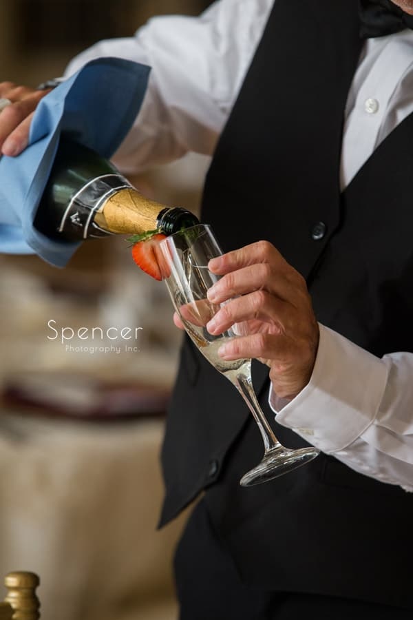 pouring the wedding champagne at Greystone Hall Akron
