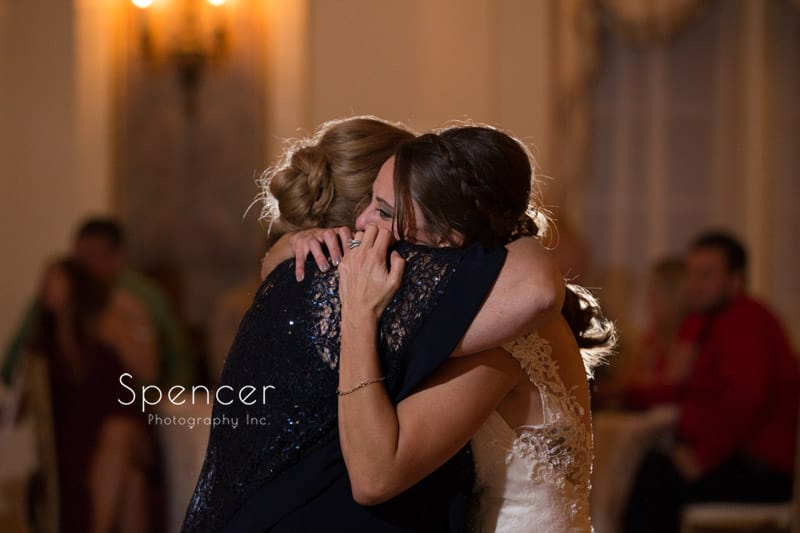 bride hugging mom at Greystone Hall wedding reception
