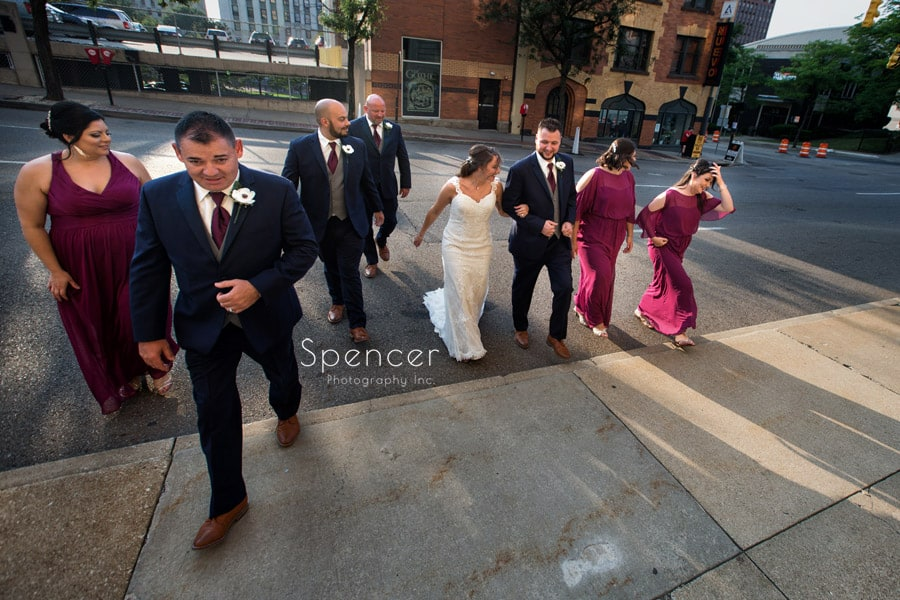 bridal party walking to Greystone Hall wedding reception