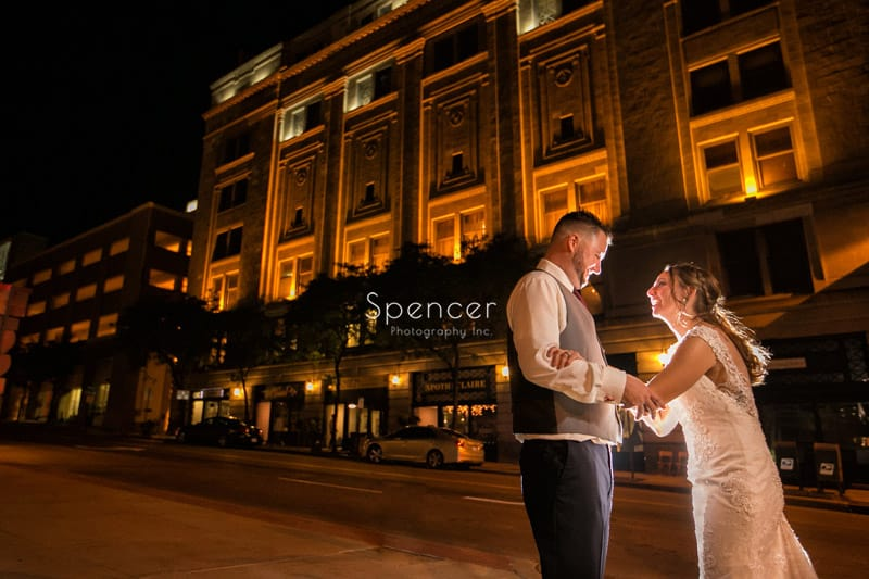 couple laughing outside of their wedding reception at Greystone Hall