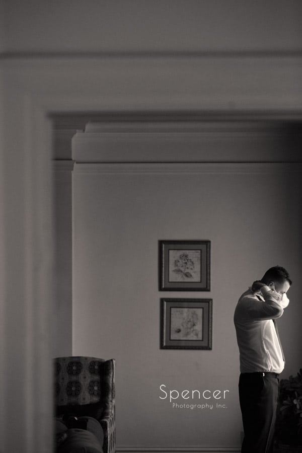 groom adjusting collar before his wedding at Greystone Akron