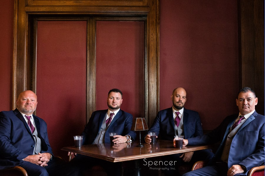 groomsmen with a drink on wedding day at Greystone