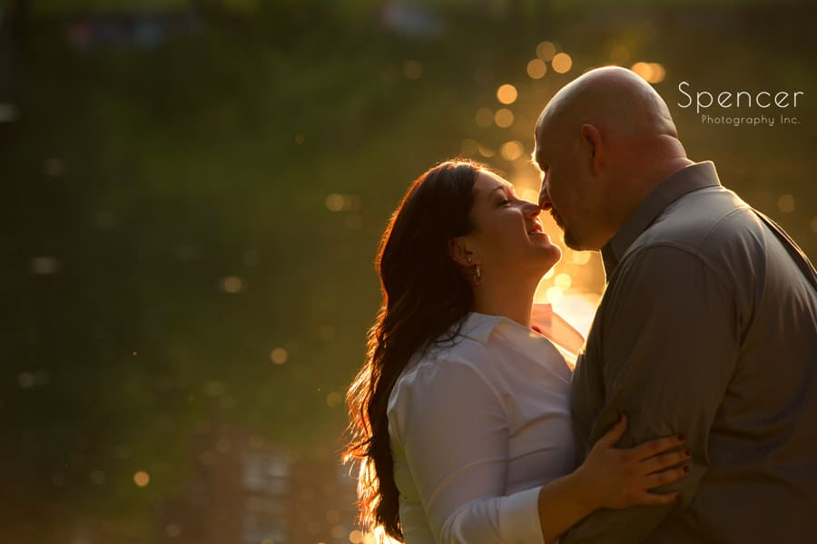 couple kissing at engagement session at wade oval lagoon