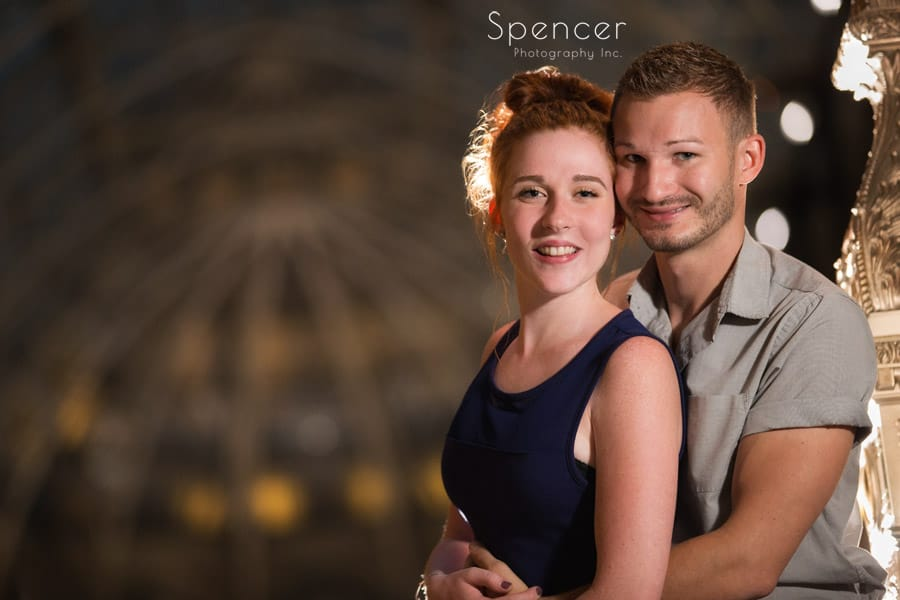 couple look into camera during engagement pictures at cleveland arcade