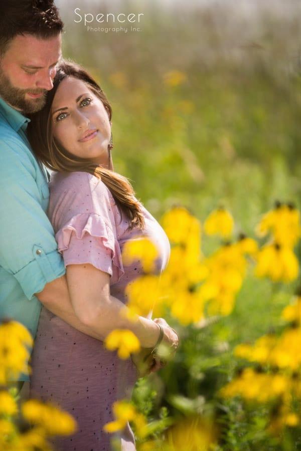 man hugging woman during akron engagement photos