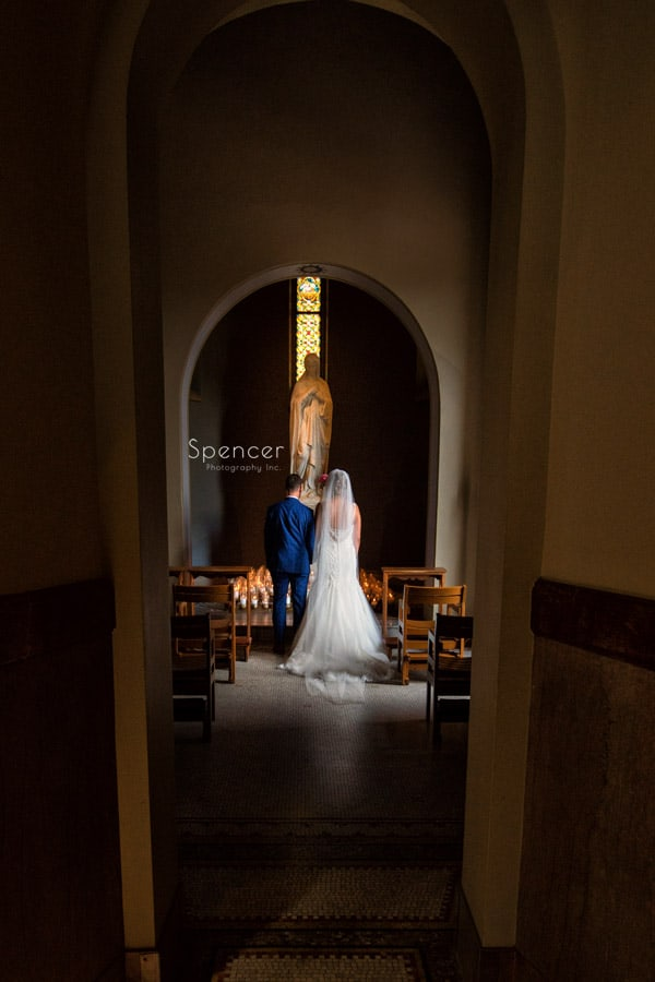 bride and groom in St. Vincent Basilica