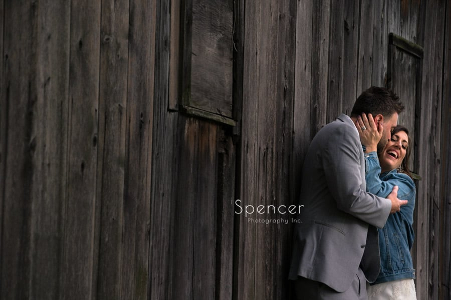 groom kissing bride at Occasions Party Center wedding