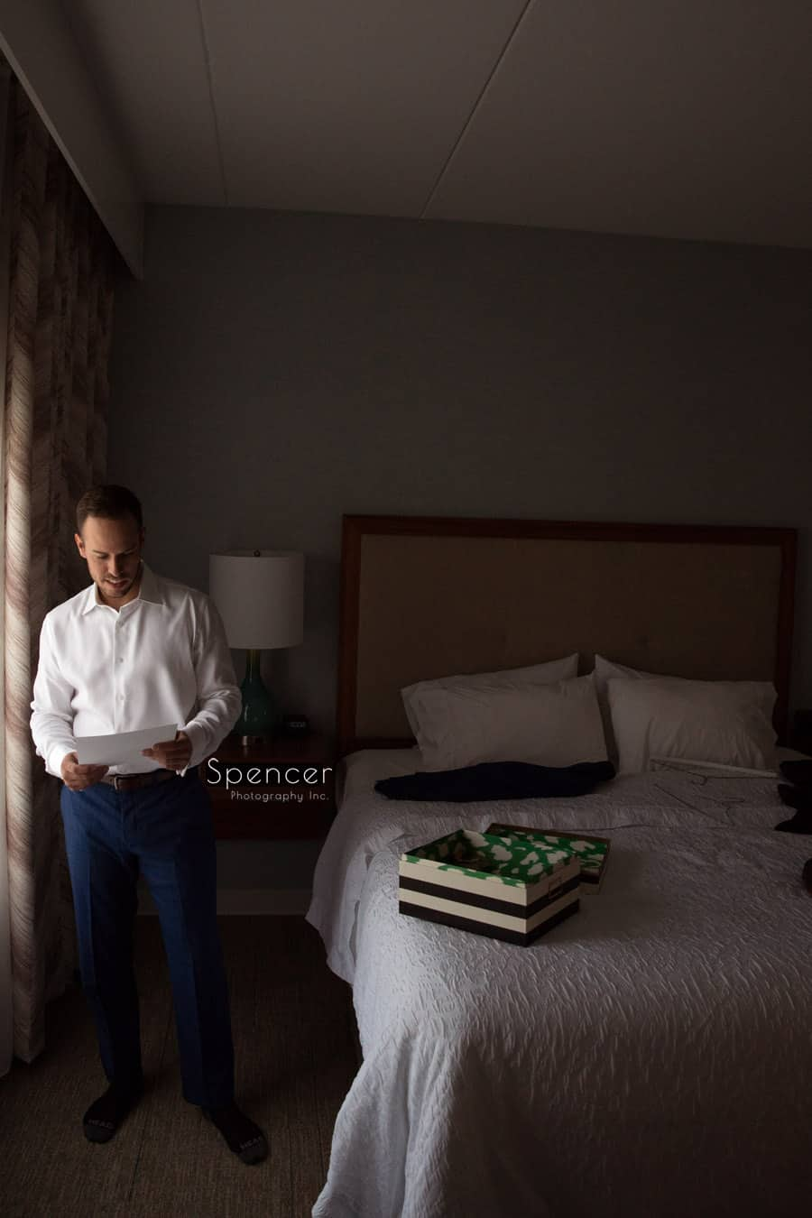 groom reading letter on wedding day at Pittsburgh hotel