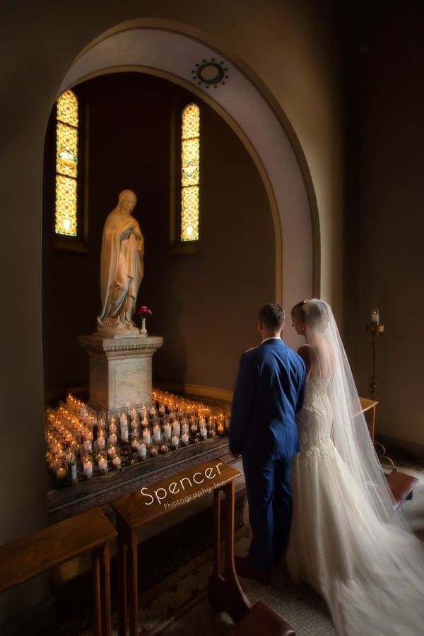bride and groom during wedding ceremony at St. Vincent Basilica