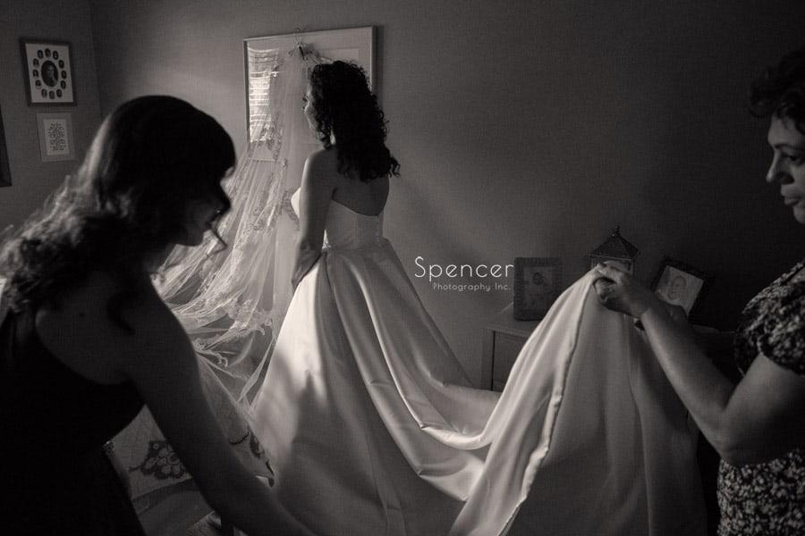 bride putting on wedding dress in akron ohio