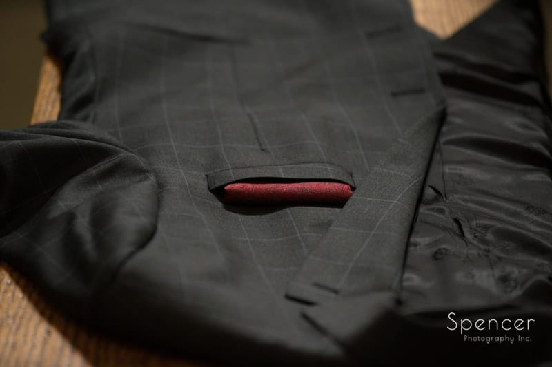 grooms wedding suit jacket sitting at Portage Country Club