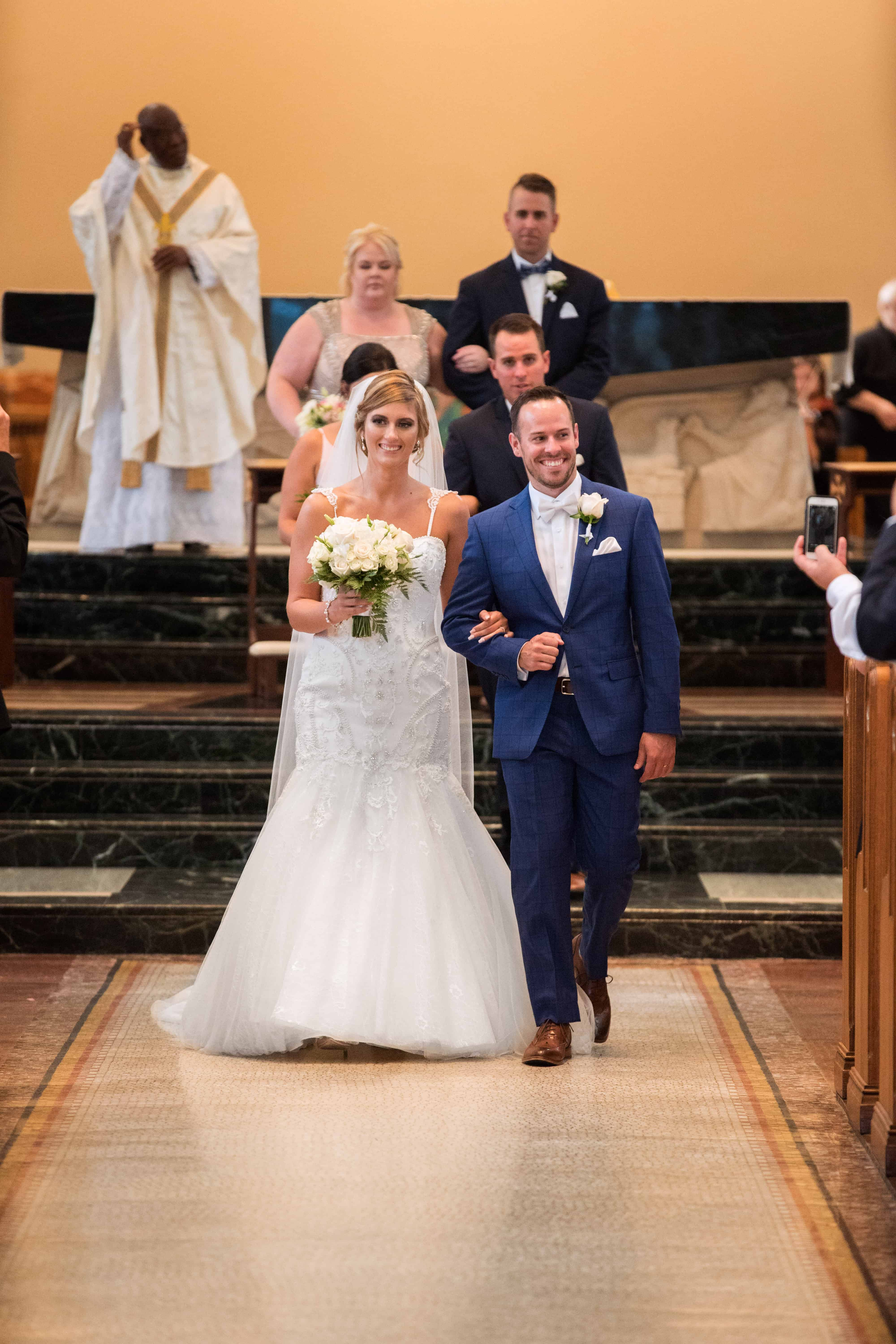 bride and groom exit their wedding ceremony at St. Vincent Basilica