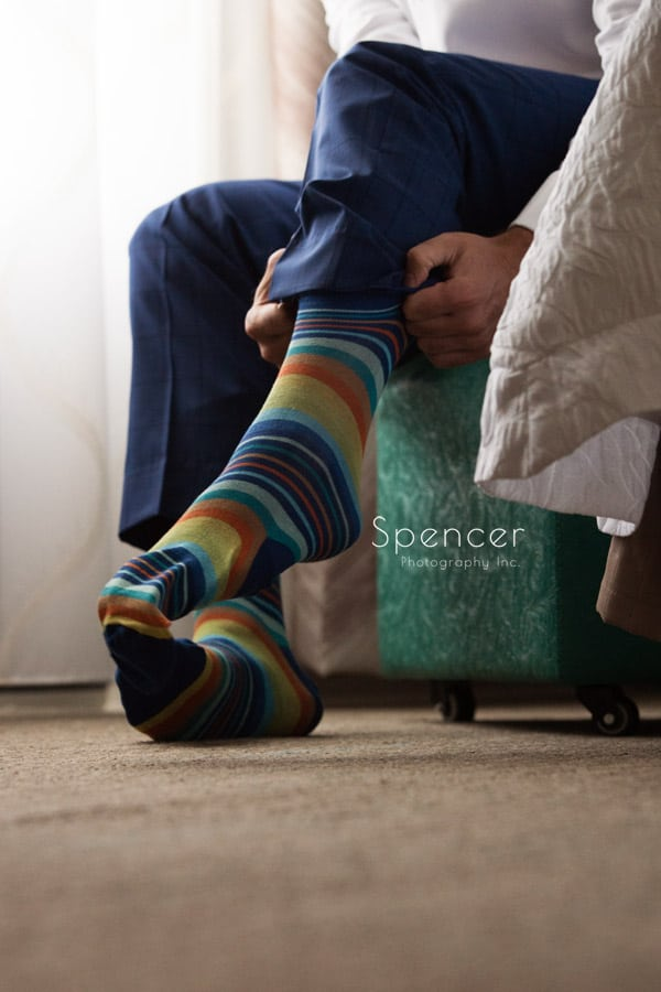 groom putting on socks during wedding day in Pittsburgh
