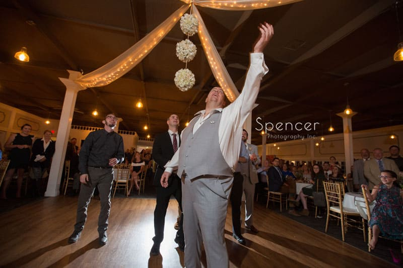 guest catching the brides garter at Occasions Party Center