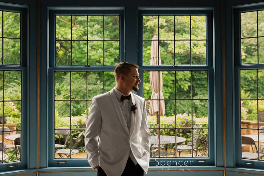 portrait of groom on wedding day at O'neil House Akron