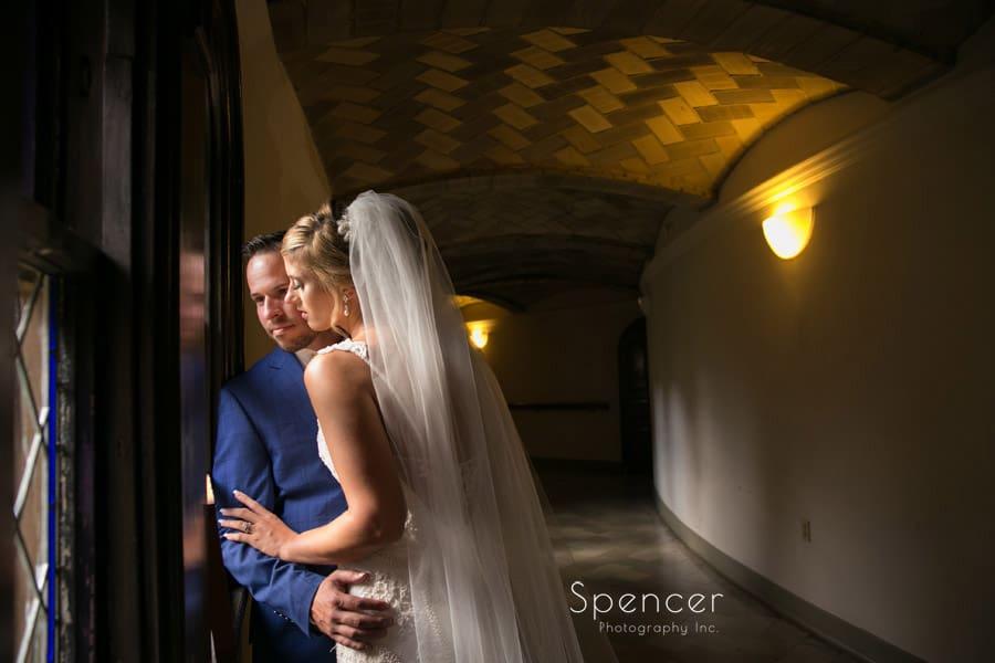 bride kisses groom after wedding ceremony at St. Vincent Basilica