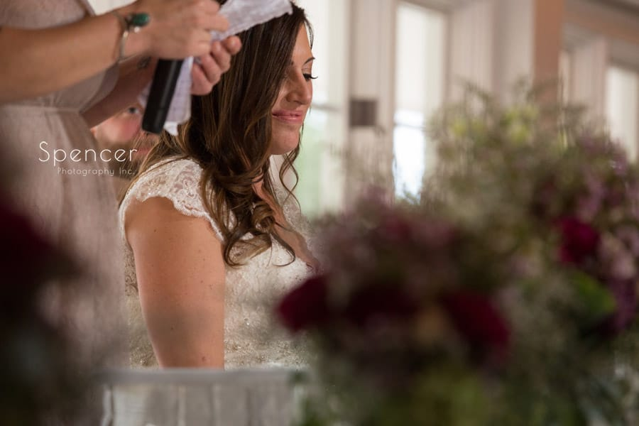 bride listening to maid of honor speech at Occasions