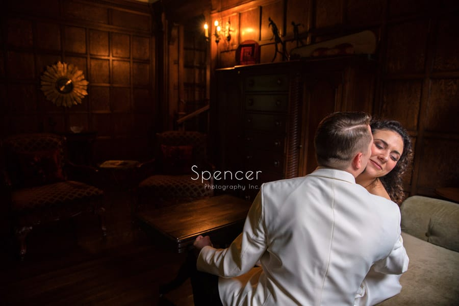 groom kisses bride on wedding day at O'Neil House Akron