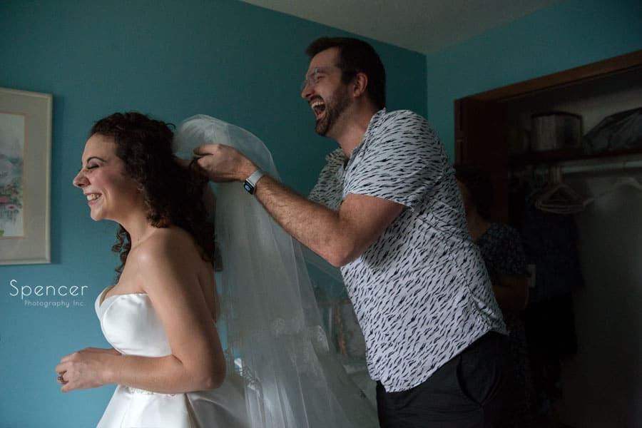 bride putting on wedding veil
