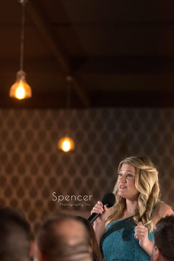 bridesmaid giving speech at akron wedding reception
