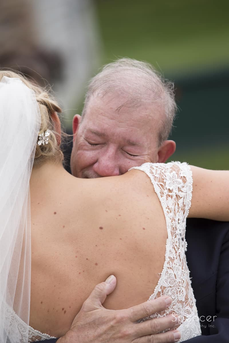 dad hugs bride on wedding day