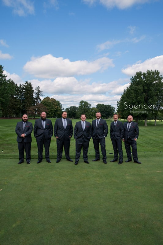 groomsmen on golf course on wedding day at Portage Country Club