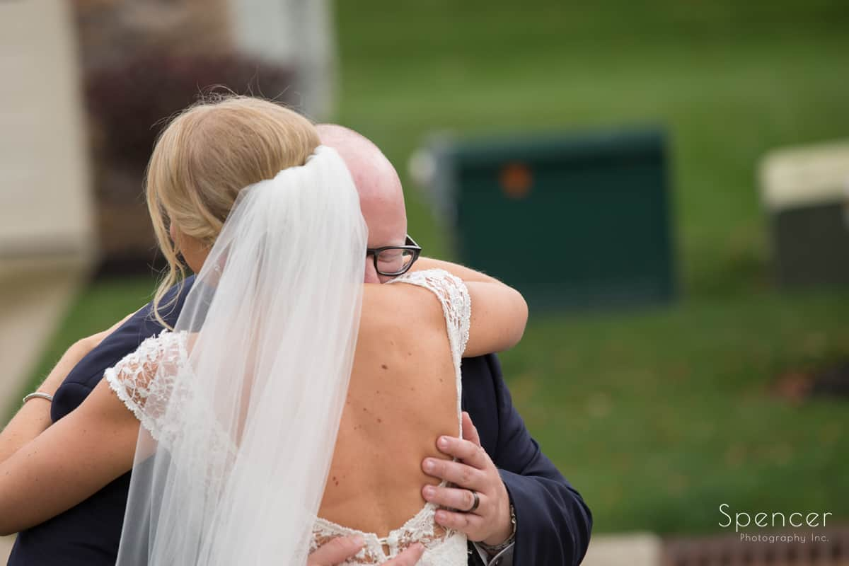 brother of bride hugging bride