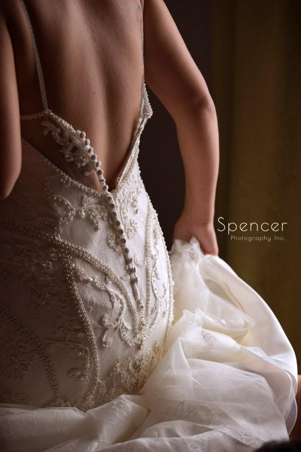 bride putting on wedding dress in Pittsburgh hotel
