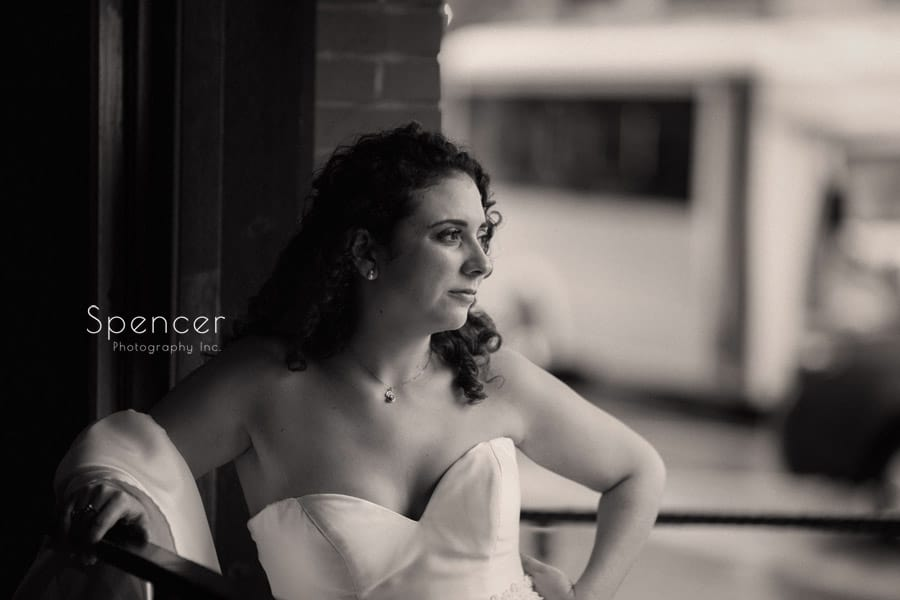 bride standing at Baxters Bar on wedding day