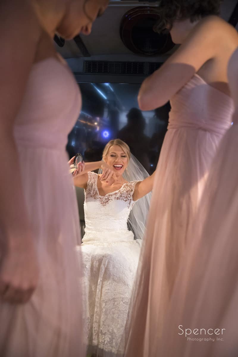 bride dancing on limo bus