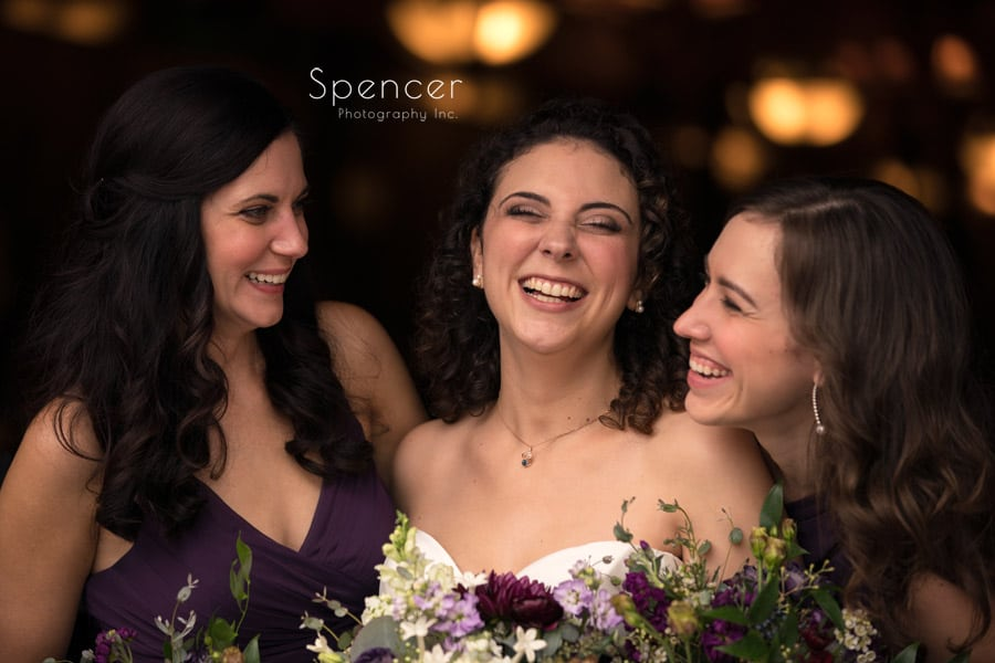 bride laughing with bridesmaids after akron wedding