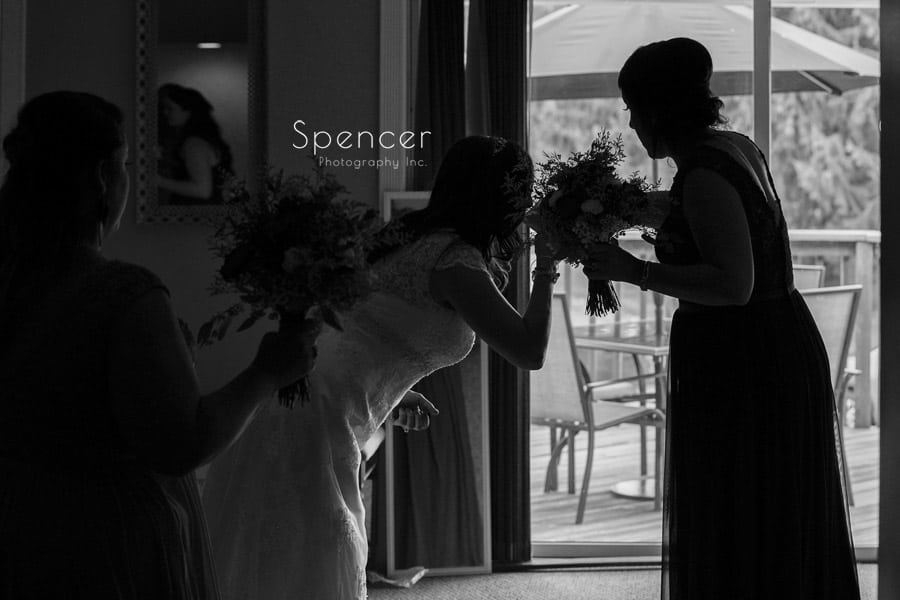 bride smelling flowers at her Akron wedding
