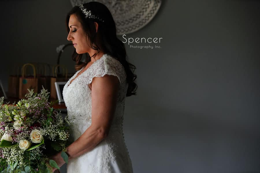 bride holding her bouquet at her akron wedding