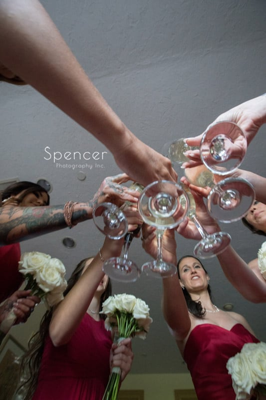 bridal party toast in wedding suite at Portage Country Club