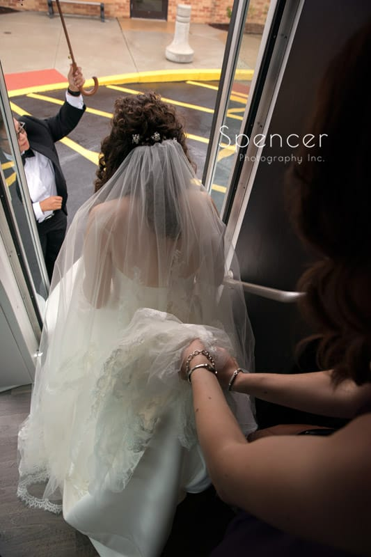 bride exiting limo for wedding ceremony in Akron