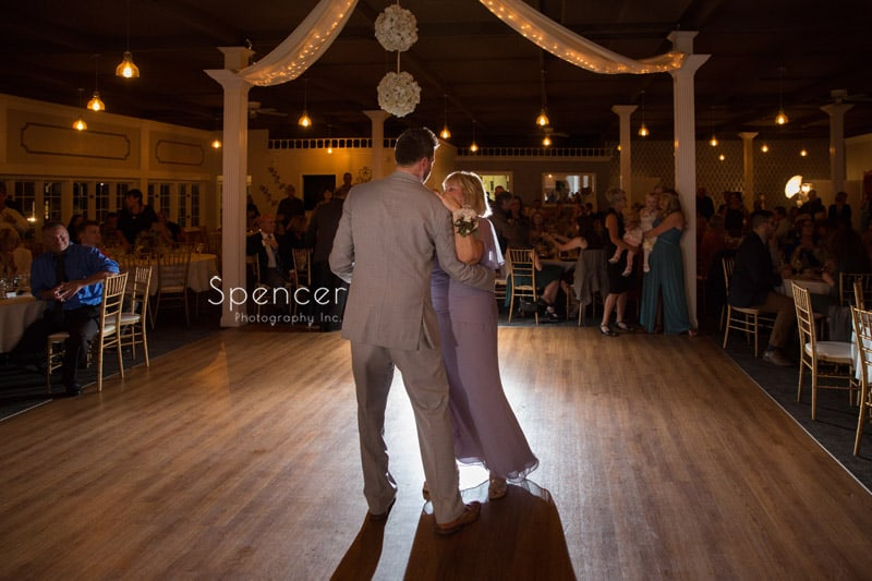 groom dancing with mom at wedding reception in akron